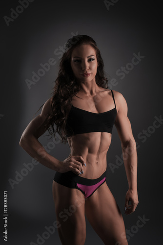 Fitness bikini. Photo of pretty female bodybuilder Poster