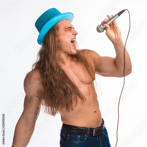 singer bodybuilder shirtless with long hair in a blue hat with a microphone on a Poster