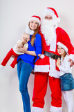 Happy family together with Santa Claus.