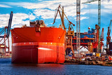 A ship under repair at shipyard in Gdansk, Poland. - 128431012