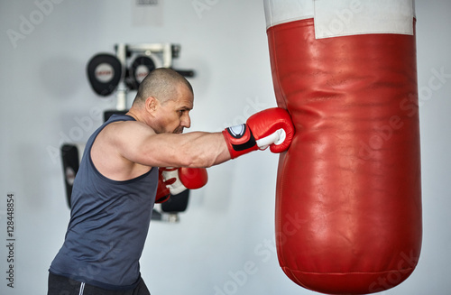 Boxer training in a gym Poster