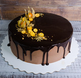 chocolate color drip cream cheese with anise and kumquat