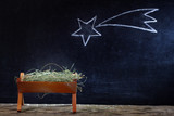 Birth of Jesus with manger and star on blackboard abstract christmas nativity scene - 128458623