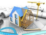 3d illustration of house construction over drawing rolls background with crane