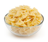 Farfalle pasta in glass bowl isolated on white background with clipping path