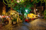 Night view of old street in Trastevere in Rome, Italy - 128464846