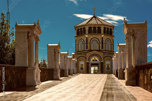 In de dag Cyprus Famous orthodox monastery of Kykkos, Holy monastery of the Virgin of Kykkos in Cyprus. Way to the church near king Macarius grave. Travel sightseeing image