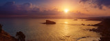 Cyprus beautiful sunrise at the sea with rocks and cloudy sky, natural panoramic background. Summer vacation concept
