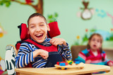 Fototapety cheerful boy with disability at rehabilitation center for kids with special needs