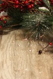 Christmas background with holiday garland on wooden board, selective focus