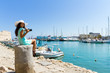Quadro Happy tourist girl on holiday trip to Heraklion, Crete, Greece.