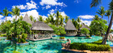 Tropical vacations. Swimming pool and lounge bar in Mauritius island - 128536617