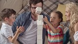 Parents and their little kids enjoying game with toy bricks, trying to make a tower higher but ruining it in the end