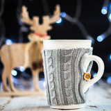Christmas Setting with Hot Chocolate in a Fancy Sweater Mug