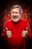 Elderly man showing ok sigh on a red background