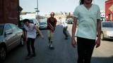 Skateboarders skating in the street