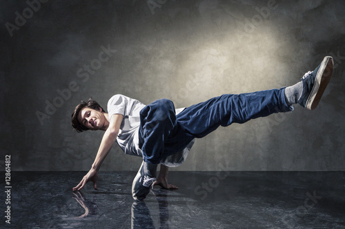 urban hip hop dancer over grunge concrete wall Poster