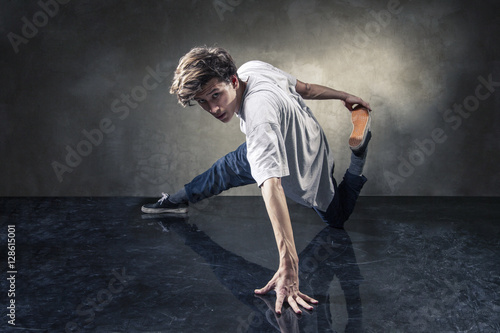 urban hip hop dancer over grunge concrete wall Poster