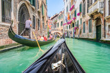 Fototapety Gondola ride through the canals of Venice, Italy