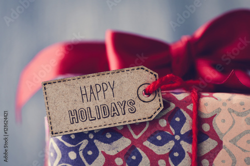 Poster gift with a label with the text happy holidays