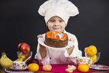 funny boy chef prepares a fruit cake