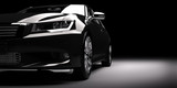 New black metallic sedan car in spotlight. Modern desing, brandless.