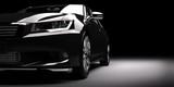 Nowy czarny samochód metaliczny sedan w świetle reflektorów. Nowoczesne desing, brandless.