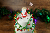 beautiful Christmas green cake on a wooden background