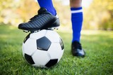 Close up view of balloon under football boots in park