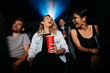 Постер, плакат: Group of people watching comedy movie in theater