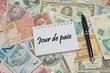 """Notebook page with FRENCH text """"JOUR DE PAIE (PAYDAY), background from different world Currencies"""