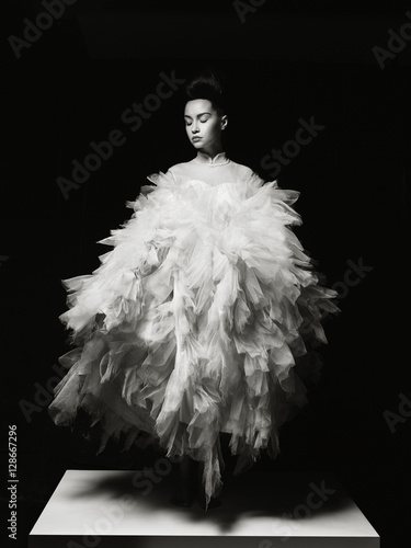 Beautiful elegant woman in luxury evening dress