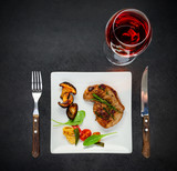 Plate with Steak, Mushrooms and Glass of Wine
