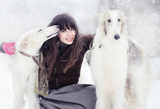 girl with two greyhounds in the winter