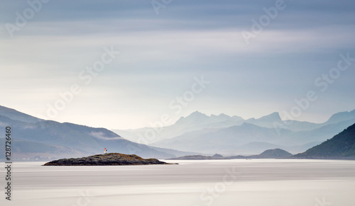 Coast of  Norway sea in clouds of haze. Beacon on a rock - 128726460