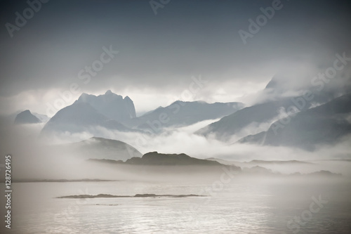 Coast of  Norway sea in clouds of fog. Cloudy Nordic day. - 128726495