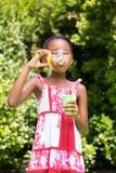 Little girl is making bubble