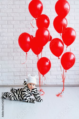 Poster Adorable baby wearing cute striped costume and red balloons