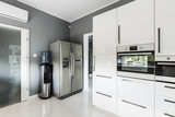 Stylish open plan kitchen with silver fridge