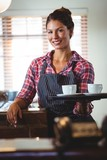 Waitress holding coffees