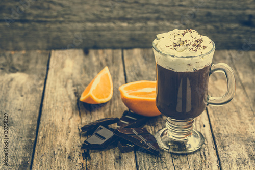 Foto op Canvas Chocolade Hot chocolate drink with whipped cream in a cup