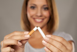 happy young beautiful woman holding a broken cigarette