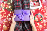 female holding a purple gift box