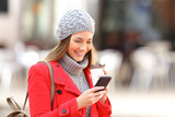 Fashion woman using a phone in winter