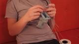 Girl knitting needles