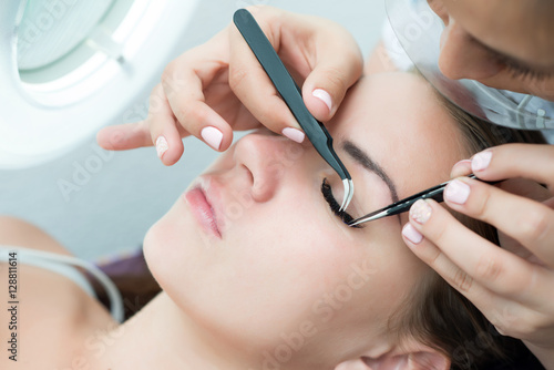 Poster Eyelash Extension Procedure.  Woman Eye with Long Eyelashes.