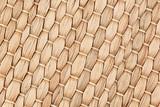 Bamboo woven beige mat handmade background. Wicker wood texture. Diagonal strips.