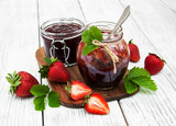 Strawberry jam and fresh strawberries