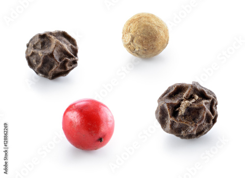 Black, red and white pepper isolated. - 128862269