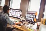 Fototapety Graphic designer using graphics tablet
